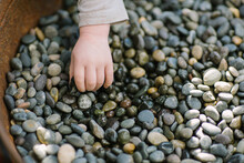 Toddler Hand Picking Up Small ...