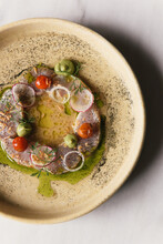 Peppered Thin Sliced Ceviche From Overhead At Fine Dining Restaurant
