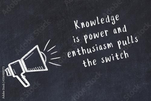 Fotografia, Obraz Chalk loudspeaker and wise quote on black desk