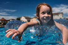 Close Up Of Young Girl Swimmin...