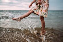 Young Girl In Dress Splashing ...