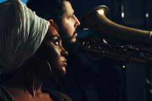 African Girl And Bearded Caucasian Man In Dark Backgrounds, Interracial Couple Of Musicians