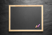 Empty Blackboard With Chalk On...