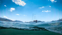 Underwater Photo Of Beautiful Yacht Floating In The Sea