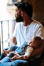 Bearded Father With Baby Sitti...