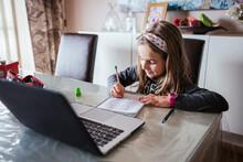 Girl Doing Homework Assignment...