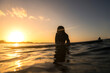 Leinwanddruck Bild - Surfer girl at sunset, Byron Bay Australia