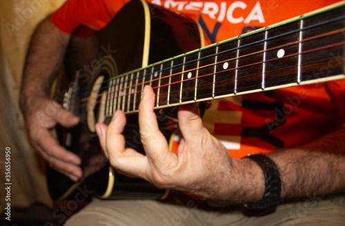The fretboard of an old acoustic guitar Fototapeta