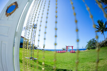 Colorful Wedding Arch Gazebo Pavilion Made Of Bamboo And Textile With Fresh Flowers Decoration At Sandy Beach On Sunny Day For Destination Wedding Ceremony In Dominican Republic