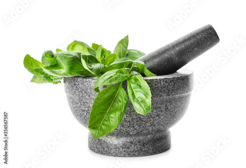 Obraz na płótnie Mortar and pestle with fresh green basil isolated on white
