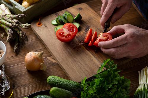 Cuadros en Lienzo Sliced tomatoes on wooden board, cooking vegan food