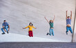 canvas print picture - Young people jumping dancing outdoor during coronavirus outbreak - Happy friends wearing face protective masks and having fun together - Social distancing and happiness concept - Main focus on faces