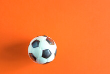 Football Ball On Orange Background With Copy Space