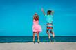 Leinwandbild Motiv happy little boy and girl play on beach