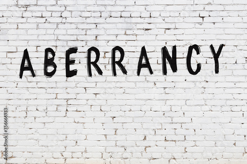 Photo Word aberrancy painted on white brick wall