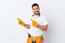 Craftsmen Or Electrician Man Over Isolated White Background Pointing Finger To The Side
