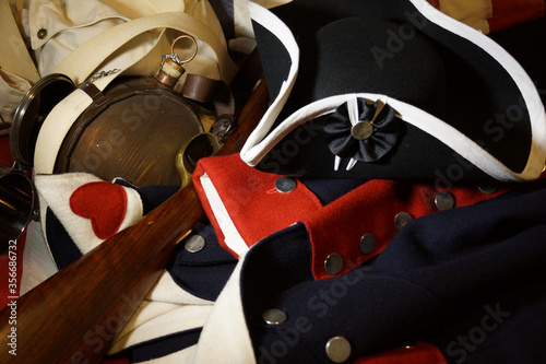 Photo Revolutionary War uniform, hat, musket and artifacts