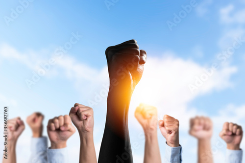 Fototapeta Black people raise their hands among the white hands to protest in the United States. About racism And racial inequality. obraz