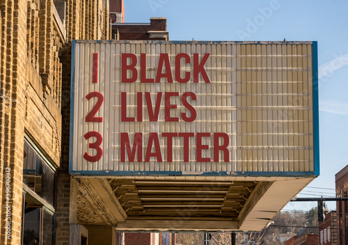 Photo Mockup of movie cinema billboard with message of Black Lives Matter on the marqu