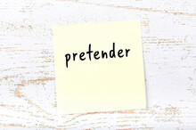 Yellow Sheet Of Paper With Word Pretender. Reminder Concept