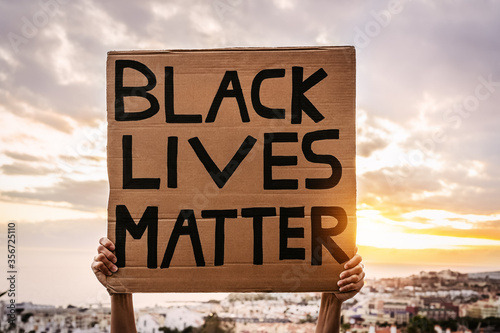 Black lives matter banner - Activist movement protesting against racism and fighting for equality - Social protests and human rights concept