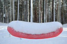 Red Snowy Swing Set Seat In Winter Forest