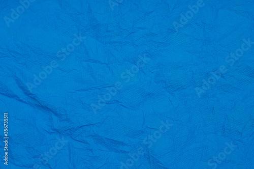 Rumpled embossed closeup napkin texture. Classic blue background Fototapet