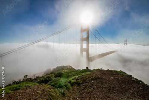 California Golden Gate Bridge emerges from the morning fog at sunrise