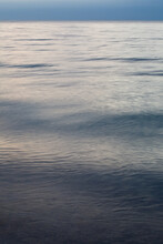 Gentle Swells Of Water On A Large Lake At Sunset