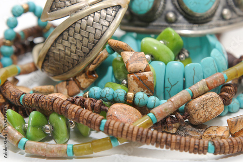 fragments of jewelry in boho style: beads, bracelets, necklaces Fototapete