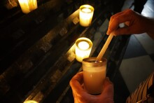 Lighting A Memorial Candle At ...