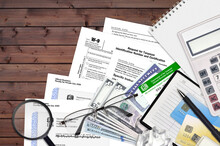 IRS Form W-9 Request For Taxpayer Identification Number And Certification Lies On Flat Lay Office Table And Ready To Fill. U.S. Internal Revenue Services Paperwork Concept