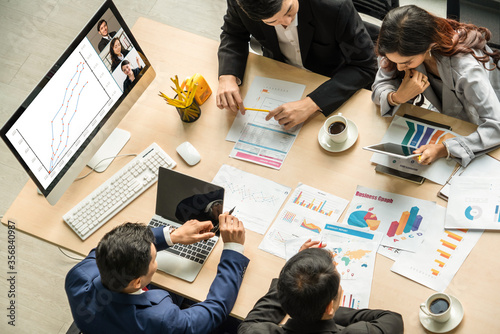 Fototapeta Video call group business people meeting on virtual workplace or remote office. Telework conference call using smart video technology to communicate colleague in professional corporate business. obraz