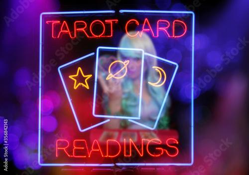 Vászonkép Psychic Card Reader Neon Sign in Rainy Window