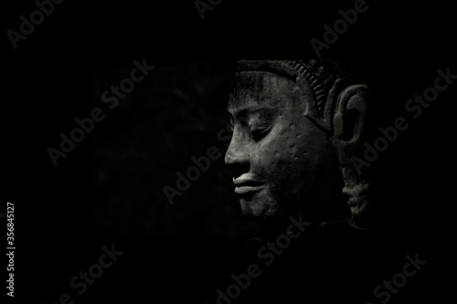On a dark background depicts an ancient statue. Wallpaper Mural