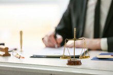 Scales Of Justice At Workplace Of Notary Public