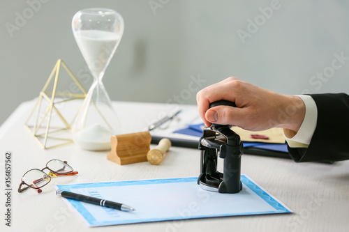 Notary public with stamp working in office Fototapet