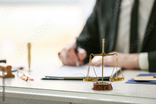 Obraz Scales of justice at workplace of notary public - fototapety do salonu