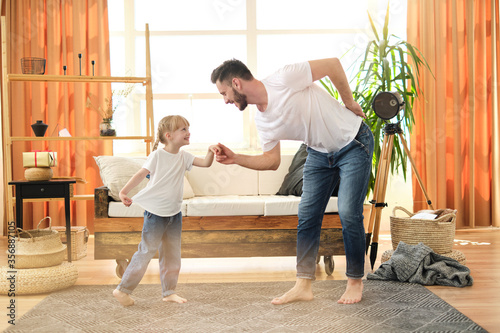 I love you, dad! Handsome young man is dancing at home with his little cute girl Tablou Canvas