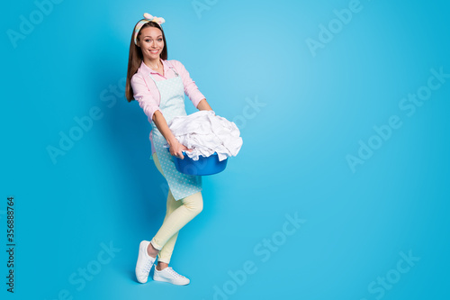 Valokuva Full length body size view of her she nice attractive cheerful housemaid carryin