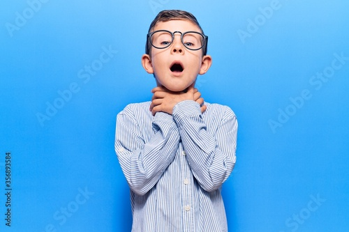 Cute blond kid wearing nerd bow tie and glasses shouting and suffocate because painful strangle Wallpaper Mural