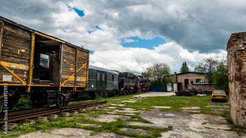 Train cars standing at the old railway station Canvas Print