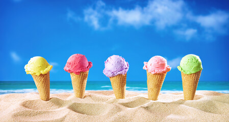 Ice creams cones and seashells in the sand on the beach