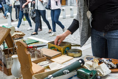 Photo Negotiating and paying at outdoor flee market.