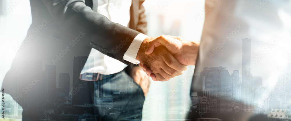 Fototapeta Businessman handshake for teamwork of business merger and acquisition,successful negotiate,hand shake,two businessman shake hand with partner to celebration partnership and business deal concept