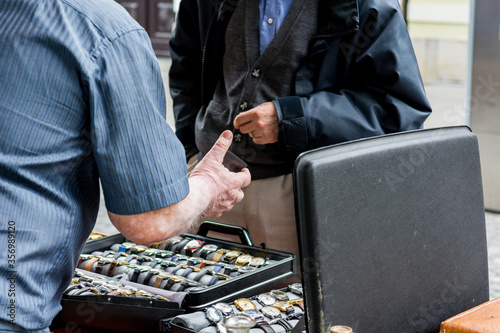 Negotiating and paying at outdoor flee market. Canvas Print