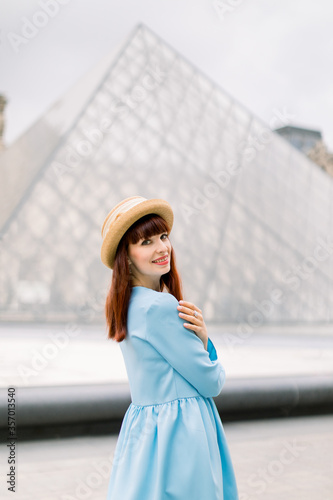 Fotografia PARIS, FRANCE - September 17, 2019: Pretty elegant young red haired woman in blu