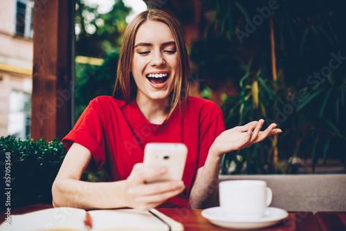 Obraz na plátně Dispirited female blogger reading repetitious news spending recreation time on s