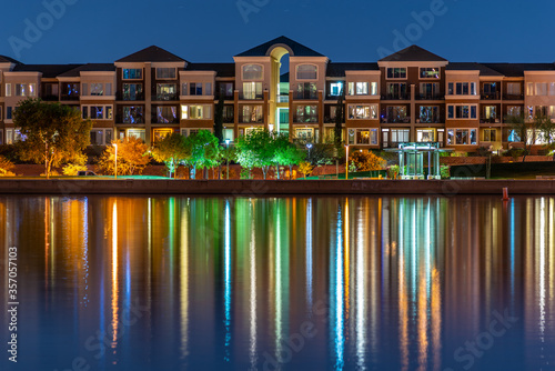 The multi-hued lights of stylish condos reflect off the calm waters of Tempe Town Lake in Arizona Fototapete