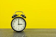 Black Retro Alarm Clock On Woo...